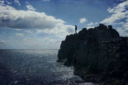 Portugal, Madeira, Camara de Lobos, One man standing on the coast, Textured effect - DWI000277