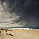 France, Contis-Plage, man at the beach, thunderclouds - DWI000290