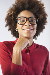 Portrait of smiling young female architect with glasses at her office - EBSF000354