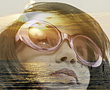 Young woman wearing sunglasses and North Sea at twilight, Double Exposure - HOHF001099