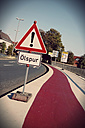 Germany, Minden, Warning sign, oil on the street - HOHF001107