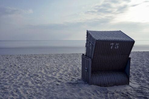 Germany, Mecklenburg-Western Pomerania, Ruegen, single hooded beach chair at Baltic seaside resort Binz - HCF000078