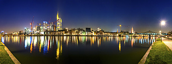 Germany, Hesse, Frankfurt, view to skylinewith Main River in the foreground at night - PUF000318