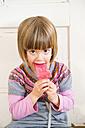 Portrait of little girl eating raspberry ice lolly - LVF002289