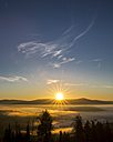 Germany, Bavaria, Bavarian Forest National Park, View from valley with waft of mist at sunrise - STSF000595