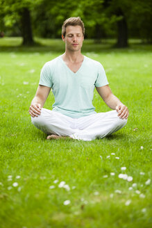 Man doing yoga in park - CvKF000163