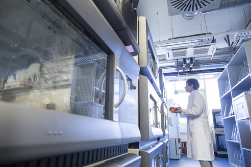 Female technician working at biochemistry labroratory - SGF001067