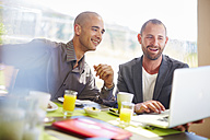 Two businessmen with laptop at dining table - ZEF002242