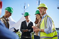Business partners having a meeting with wind turbine engineer - ZEF002247