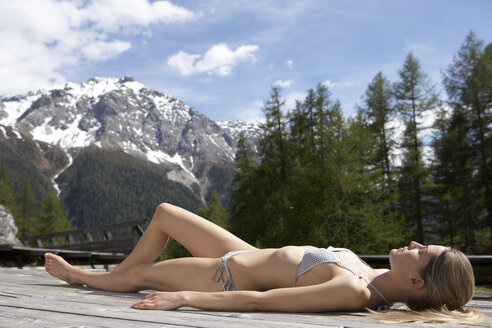 Switzerland, woman sunbathing on sun deck - FSF000367