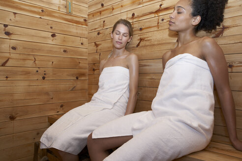 Two young women sitting in a sauna - FSF000373