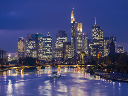 Germany, Hesse, View of Frankfurt am Main, Floesserbruecke and financial district at night - AMF003231