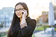 Portrait of young businesswoman telephoning with smartphone - MAD000103