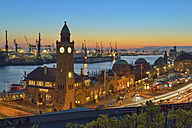 Germany, Hamburg, Port of Hamburg and Landungsbruecken at sunset - RJ000359