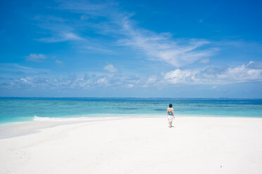 Maledives, Ari Atoll, young woman walking at dream beach - FLF000589