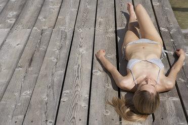 Woman sunbathing on sun deck - FSF000378