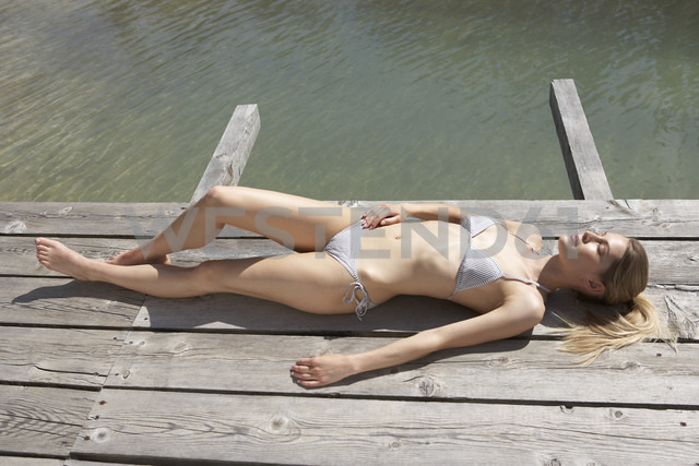 Switzerland, woman sunbathing on sun deck - FSF000402 - Sandra Bielmeier/Westend61