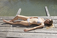Switzerland, woman sunbathing on sun deck - FSF000402