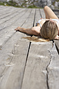 Young woman sunbathing on sun deck - FSF000355