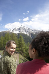 Switzerland, two young women on a view terrace - FSF000360