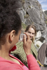 Switzerland, woman taking a photo of her female friend - FSF000361