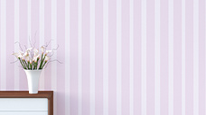 Sideboard with flower vase in front of  striped pink wallpaper - UWF000258