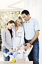 Parents and daughter looking after baby boy - GDF000584
