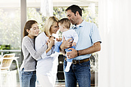 Parents and daughter looking after baby boy - GDF000586