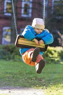 Little girl hanging on a swing - JFEF000560