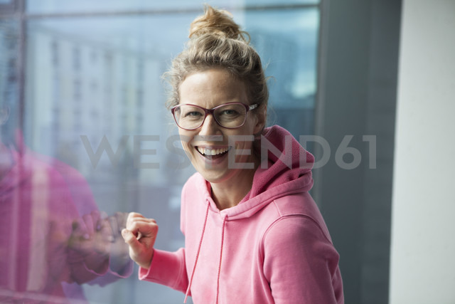 Portrait of laughing mature woman with pinkhooded jacket - RBF002052