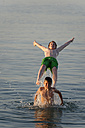 Italy, two teenage boys having fun at seaside - LBF000994