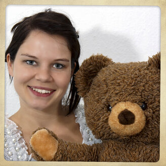 Young woman holding teddybear - HOHF001149