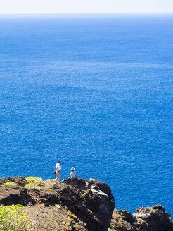 Spain, Canary Islands, La Palma, tourists at the cliff coast of Garafia - AMF003261