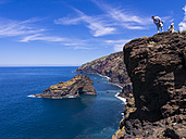 Spain, Canary Islands, La Palma, tourists at the cliff coast of Garafia - AMF003258