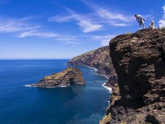 Spain, Canary Islands, La Palma, tourists at the cliff coast of Garafia - AMF003258