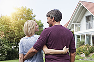 Rear view of mature couple in garden - RBF001932