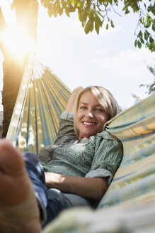Relaxed mature woman in hammock - RBF001959