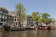 Netherlands, Amsterdam, view to houseboats at town canal and row of  houses - FCF000506