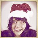 Woman wearing Santa hat - HOHF001174