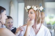 Bride getting ready for wedding with bridesmaid - ZEF002527