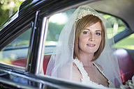 Bride sitting in car before wedding - ZEF002570