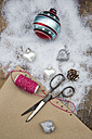 Christmas baubles, scissors, string, packing paper and artificial snow - LVF002328