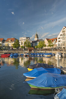 Germany, Baden-Wuerttemberg, Lake Constance, Friedrichshafen, covered boats at jetty - SHF001757