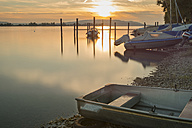 Germany, Baden-Wuerttemberg, Lake Constance, Allensbach, boats at shore at sunset - SHF001671