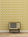 Old television in front of yellow patterned wallpaper - UWF000273