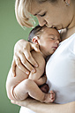 Newborn baby boy sleeping in mother's arms - OJF000089