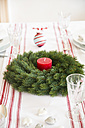 Red-white laid table with Advent wreath at Christmas time - LVF002357