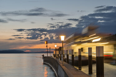 Germany, Baden-Wuerttemberg, Lake Constance, Meersburg, ferry at pier at dusk - SHF001765