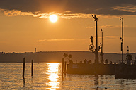 Germany, Baden-Wuerttemberg, Lake Constance, Meersburg, harbor entrance with sculpture magical pillar at sunset - SHF001767
