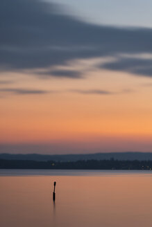 Germany, Baden-Wuerttemberg, Lake Constance, Meersburg, art installation sea mark at sunset - SHF001769